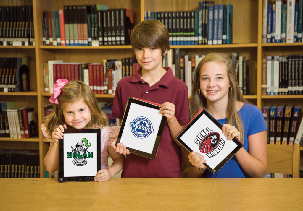 Students with iPads with school logos